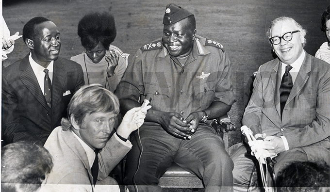 Amin with the British minister