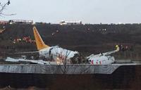 Plane skids off runway, breaks into two