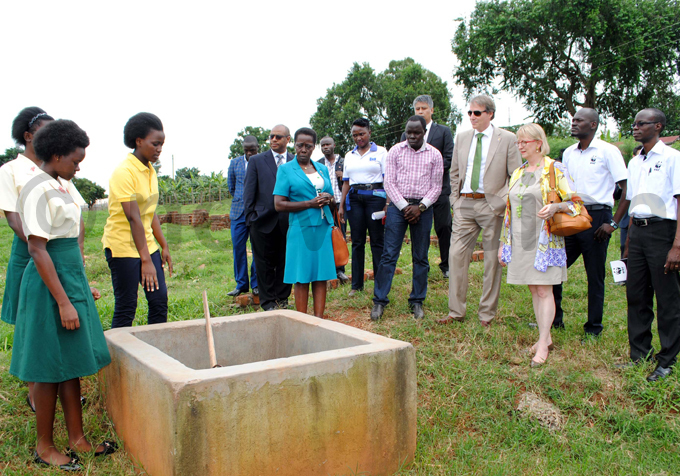 ayaza igh chool students lizabeth ahane and uth race akiwoto explain the biogas process hoto by ary ansiime
