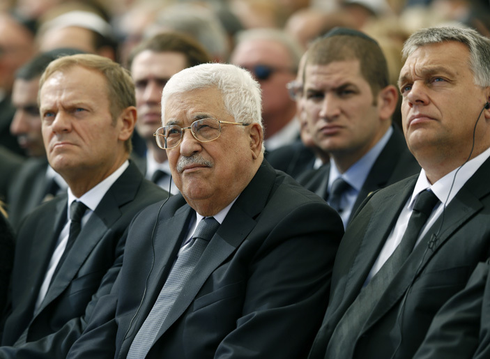 alestinian president ahmud bbas  sits alongside uropean ouncil resident onald usk  and omanian resident laus ohannis at erusalems ount erzl national cemetery during the funeral of former sraeli president himon eres on eptember 30 2016  hoto  ool  bir ultan