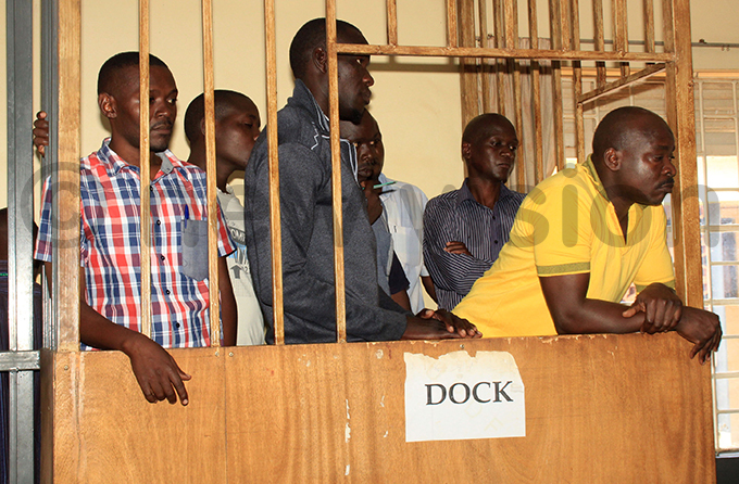 itatta and some of the codefendants during a court appearance in ovember last year ile hoto