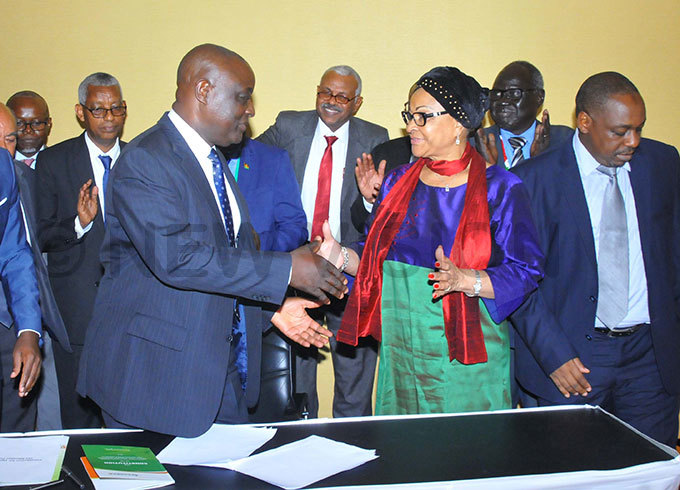 inister  of griculture incent sempijja  being congratulated by  the ommissioner of ural  conomy  and griculture  frican nion  osefa  eonel acko at the signing  communique  of the   atron inisters ummit at unyonyo ampala hoto by ilfred anya