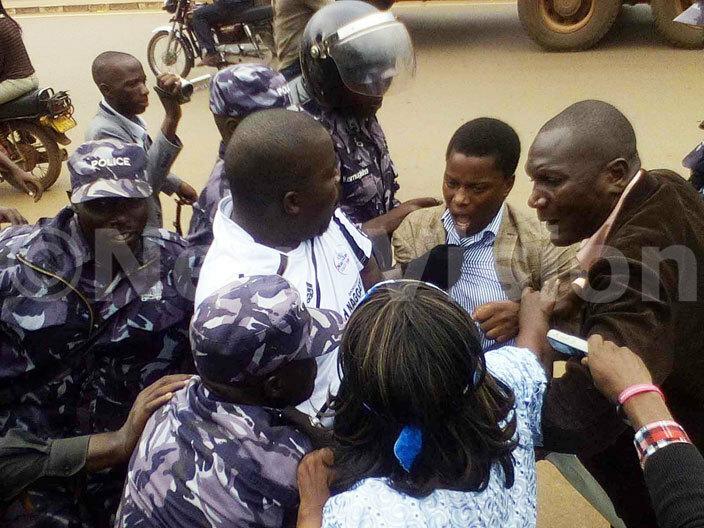 ampala woman  abilah aggayi  akindye division mayor li ulyanyama and other councillors battling police to access the  offices hoto awrence ulondo