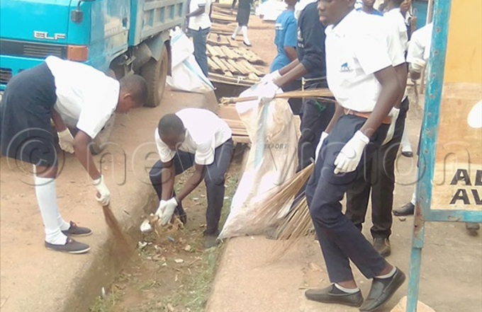 ome of the students cleaning drainage channels
