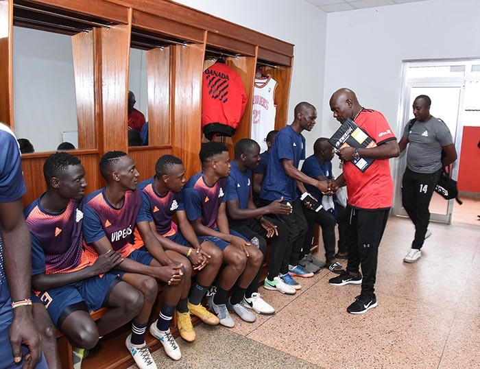red ajoba and his assistant brahim ugisha greets players in the dressing room icture y palanyi sentongo