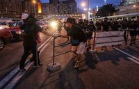 Hong Kong protesters defy police with 'hit-and-run' rallies