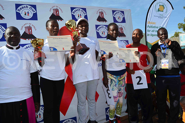ome of the winning female participants in a group photo with sgr awrence semusu and r ohn ungereza