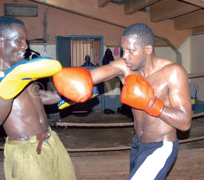odfrey yakana  in training with eo anana at  gym in preparation for a non title ommon wealth elimination fight against swald aneno of anzania ec 9 2003