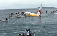 Plane overshoots runway and ditches into lagoon