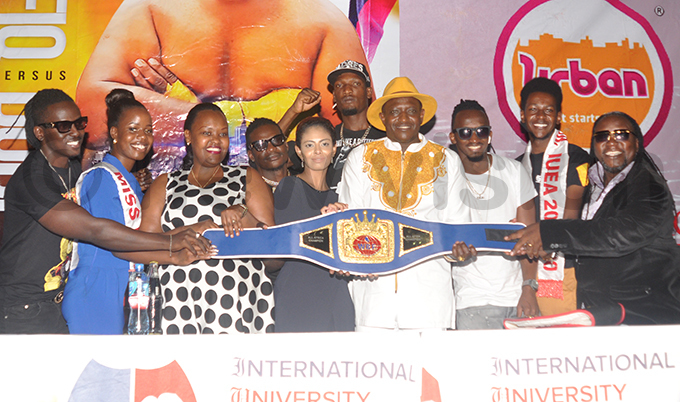 ighters sponsors and promoters pose with the  belt during a press conference at the nternational niversity of ast frica ahead of the ovember 29 fight hoto by ichael subuga