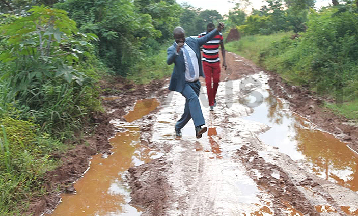 asangati mayor onny sempebwa navigates the muddy galamye oad which he says will be graded again soon hoto by amuel ebuseeke
