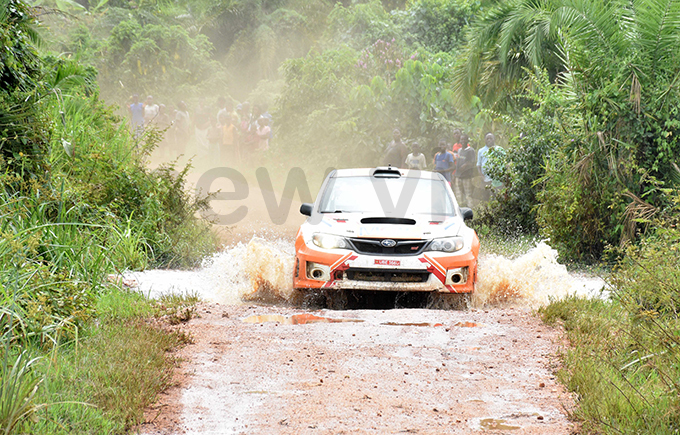 asin asser powers his ubaru through a wet section of the course hoto by ohnson ere