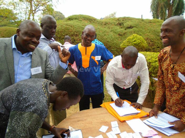 yenga eminary alumni registering on arrival for their function