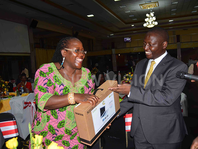 on ahati right donating a laptop that r uhakana ugunda bought at sh5m to rof osephine hikire