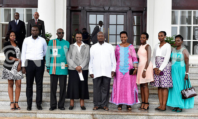resident oweri aguta useveni the first lady anet useveni and the incoming security inister lly umwine together with his family members pose for a group photograph shortly after the swearing in ceremony at tate ouse ntebbe