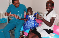 Girl born with intestines out awaits operation