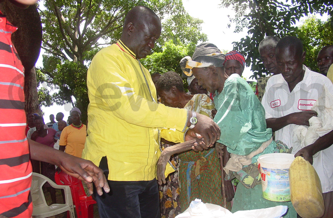 cweru sympathises with an old woman who was very weak as a result of food shortage hoto by braham lapu
