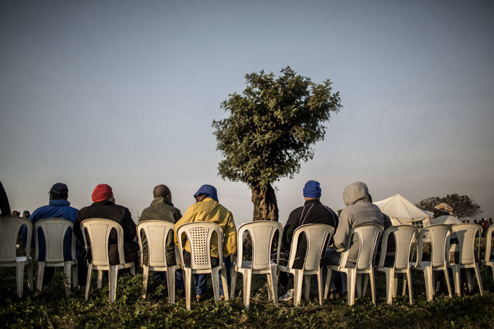 outh frican voters wait at a polling station