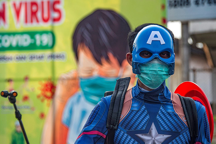 n ndonesian police officer wearing a superhero costume on the street disinfects motorists vehicles in asuruan ast ava on pril 9 2020 amid concert to the 19 coronavirus hoto by