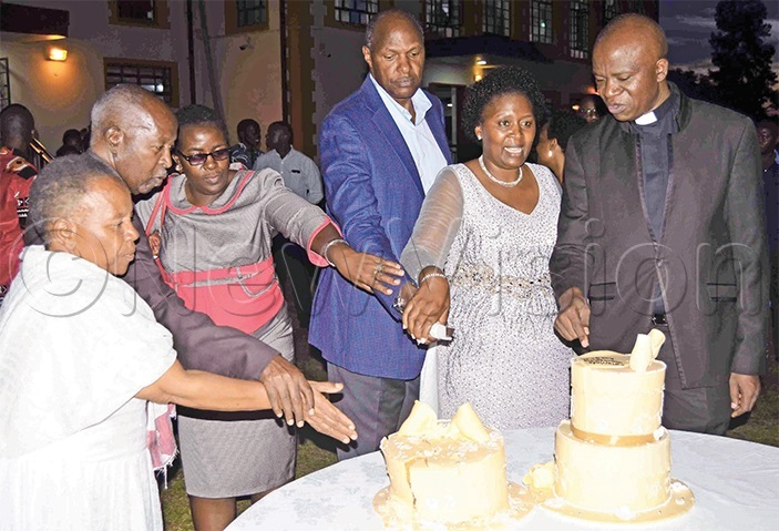 he ugaruras the antaates and the siimwes cutting a cake during the thanksgiving ceremony in akerere recently