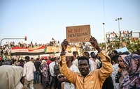 Protesters throng Khartoum a week after Bashir ouster