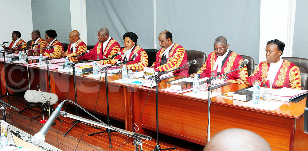 A panel of Supreme Court judges led by Chief Justice Bart Katureebe. Photo by Nicholas Oneal