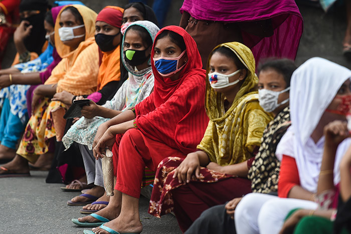 orkers from the garment sector block a road during a protest to demand payment of due wages in haka on pril 15 2020 hoto by