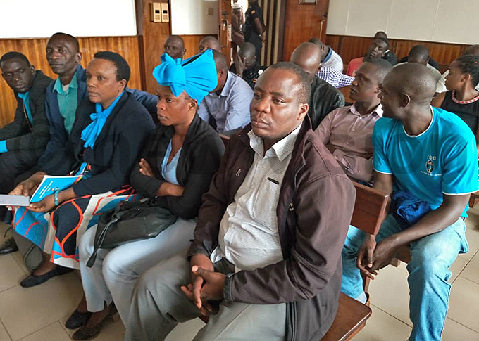 ngrid urinawe 3rd left in court with the six suspects in court hoto by uth aith akanwagi