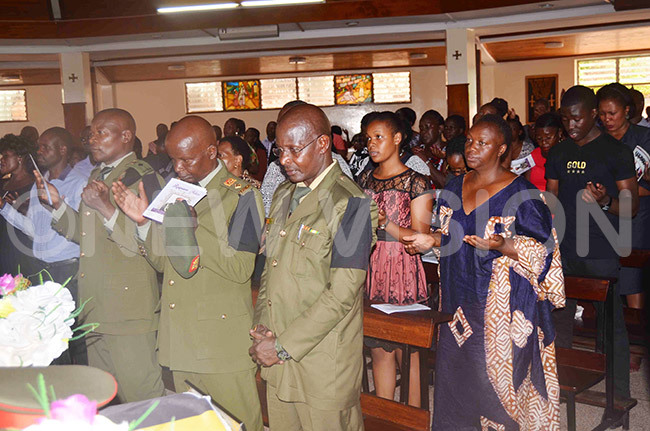 officers and other mourners during the requiem mass for the late t ol harles damulira