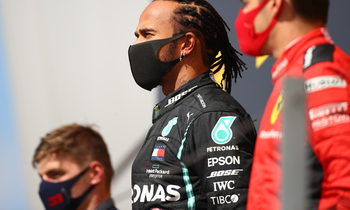 Mercedes british driver lewis hamilton stands on the winners podium after winning the formula one british grand prix afp photo 350x210