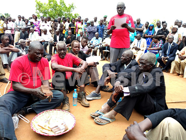 lders from ageya clan officiating the payment of sh14m given by the resident to pay for the lives of those that were killed hoto by rnest umwesige
