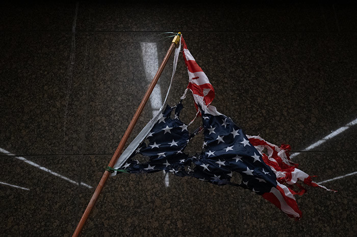 torn and burnt upside down merican flag hangs as protesters march through the streets of etroit ichigan for a second night ay 302020 protesting the killing of eorge loyd who was killed by a white officer who held his knee on his neck for several minutes during an arrest in inneapolis on onday hoto by