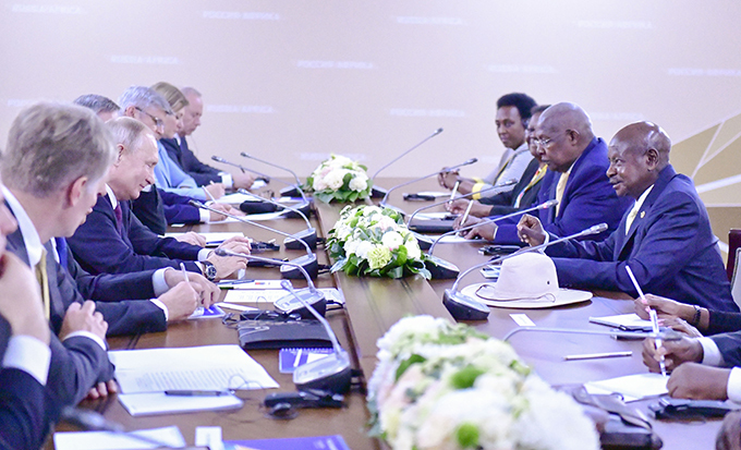 he delegations from ganda and ussia meeting on the sidelines of the summit in ochi  hoto