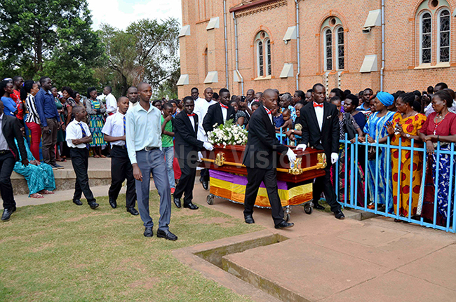 he casket containing the remains of eacon ndrew rian ayega being rolled to the burial place by the pallbearershis was during the burial ceremony at ubaga athedral on onday ugust 5 hoto by athias azinga