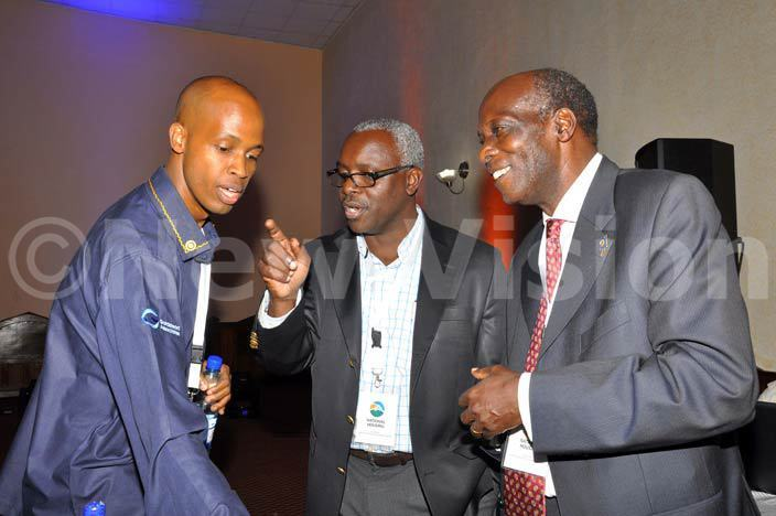 he ision roup managing director obert abushenga centre talks to motivation speaker than ussoloni left and consultant r bel atahoire during the otary  conference and assembly at mperial resort each otel in ntebbe on hursday ay 5 2015 hoto by rancis morut