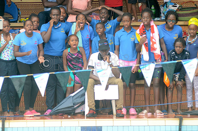 olphins swimmers cheeron their colleagues during a local event