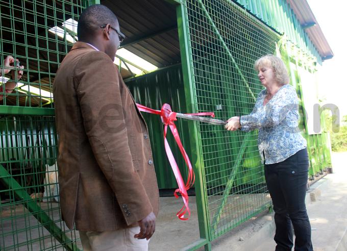 lison lackburne cuts the ribbon as ndrew eguya looks on hoto by itus akembo