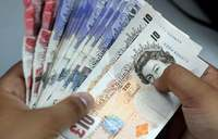 Pound rises versus dollar on May's Brexit gamble