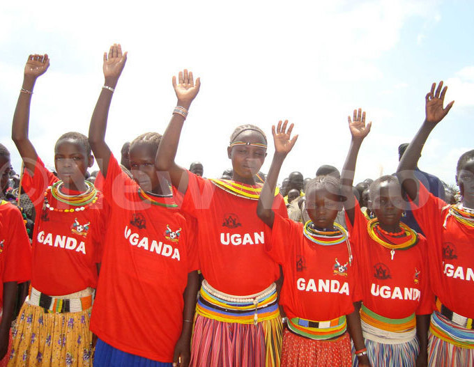 okot girls take an oath against female genital mutilation during culture day celebrations in ween district on ovember 01 2010 ile hoto