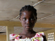 girl-with-xo-classroom-sierra-leone-by-one-laptop-per-child