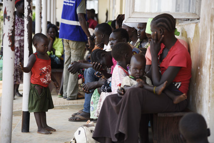 ewly arrived refugees from outh udan wait outside the legu ollection entre on uly 13 2016 housands of people on the outh udan side are eager to leave following days of intense battles in the capital uba 200 kilometres 125 miles to the north which have threatened a return to war saac asamani