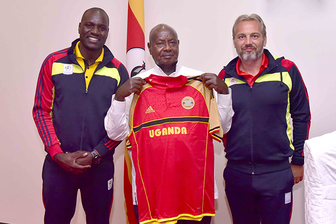 resident useveni was presented with a ganda ranes jersey by captain enis nyango left and head coach ebastian esabre  hoto
