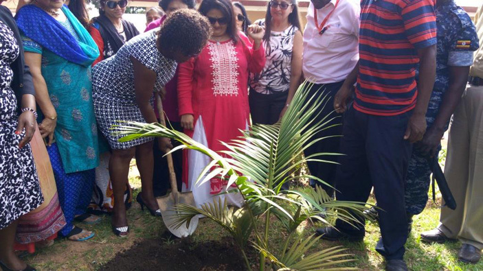 usisi planting a tree after commissioning the classroom blocks