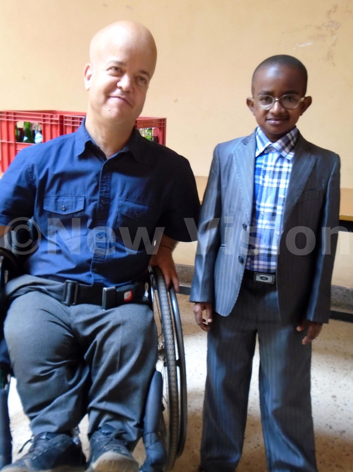 rof om hakespeare left poses for a photo with  uild resident  hahali ugamba during the function