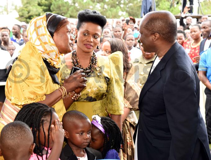 uganda minister in charge royal visits chats with the abaka utebi while the abagereka ylvia agginda looks hoto by ennedy ryema