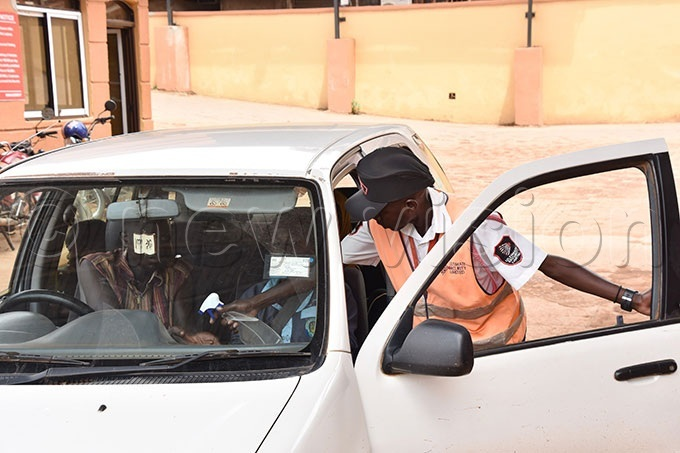 security man at asis all in ampala sprays hand sanitizer on a driver and passenger entering the premises on hursday leaning hands with hand sanitizer is one of the measures to safe guard oneself from getting the oronavirus