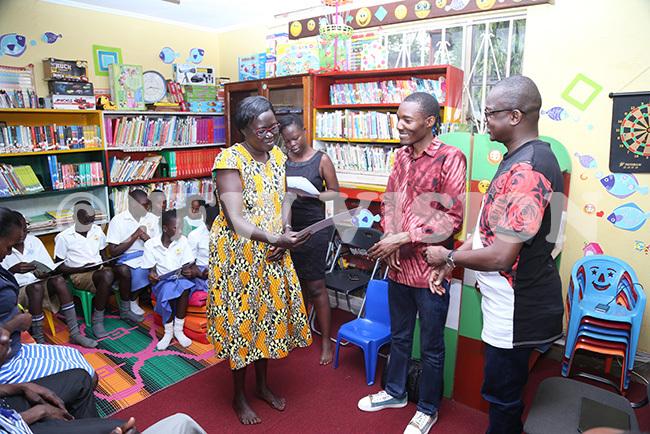 teacher receives her schools certificate