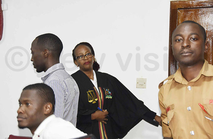 agistrate ladys amasanyu leaves the courtroom after the chaos broke out ile hoto