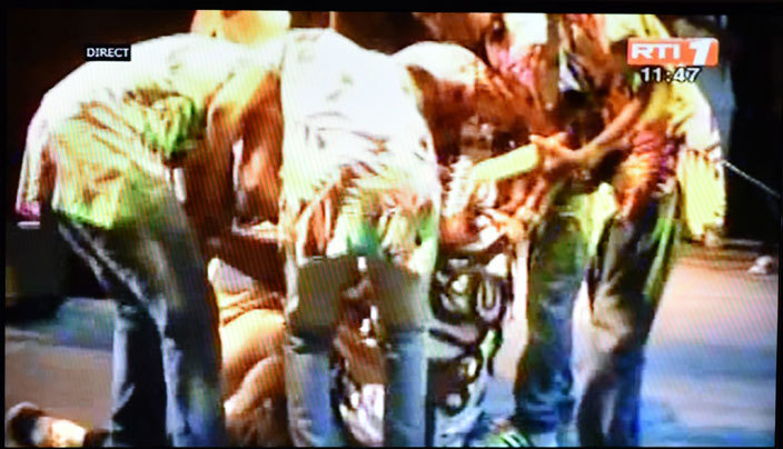 still frame taken from vory oast national television  1 on pril 24 2016 shows ongolese music star apa emba collapsing on stage during the  music festival in bidjan