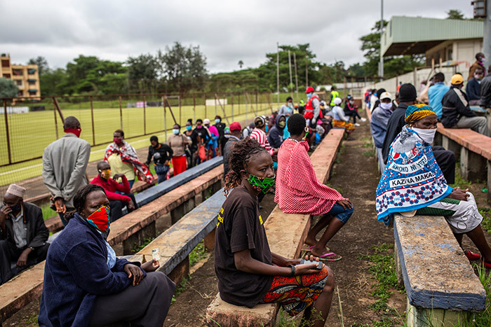 eople wait while adhering to social distancing for a food distribution that will provide two boxes containing maize flour cooking fat salt and green grams for over 250 people by the enya ed ross during the 19 pandemic in airobi enya on ay 1 2020 hoto by atrick einhardt